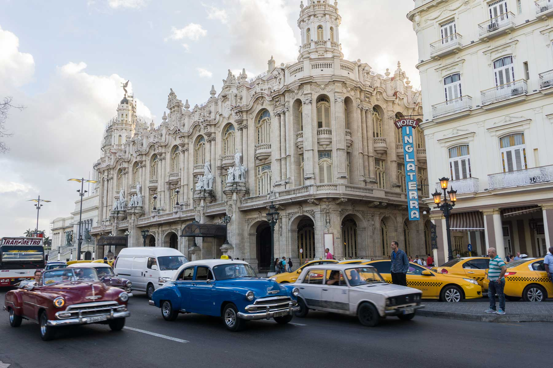 Classic cars on the street next to Hotel Inglaterra in Havana, Cuba