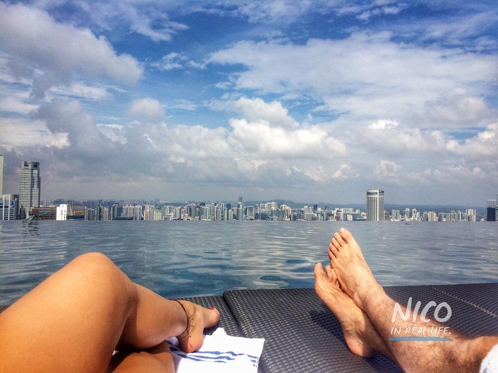 Katie & Felipe Mejia relaxing by the pool