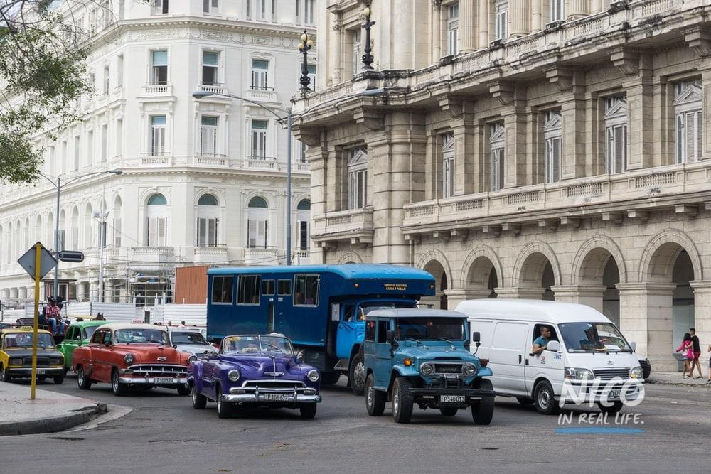 Traffic in Havana, Cuba featuring vintage cars