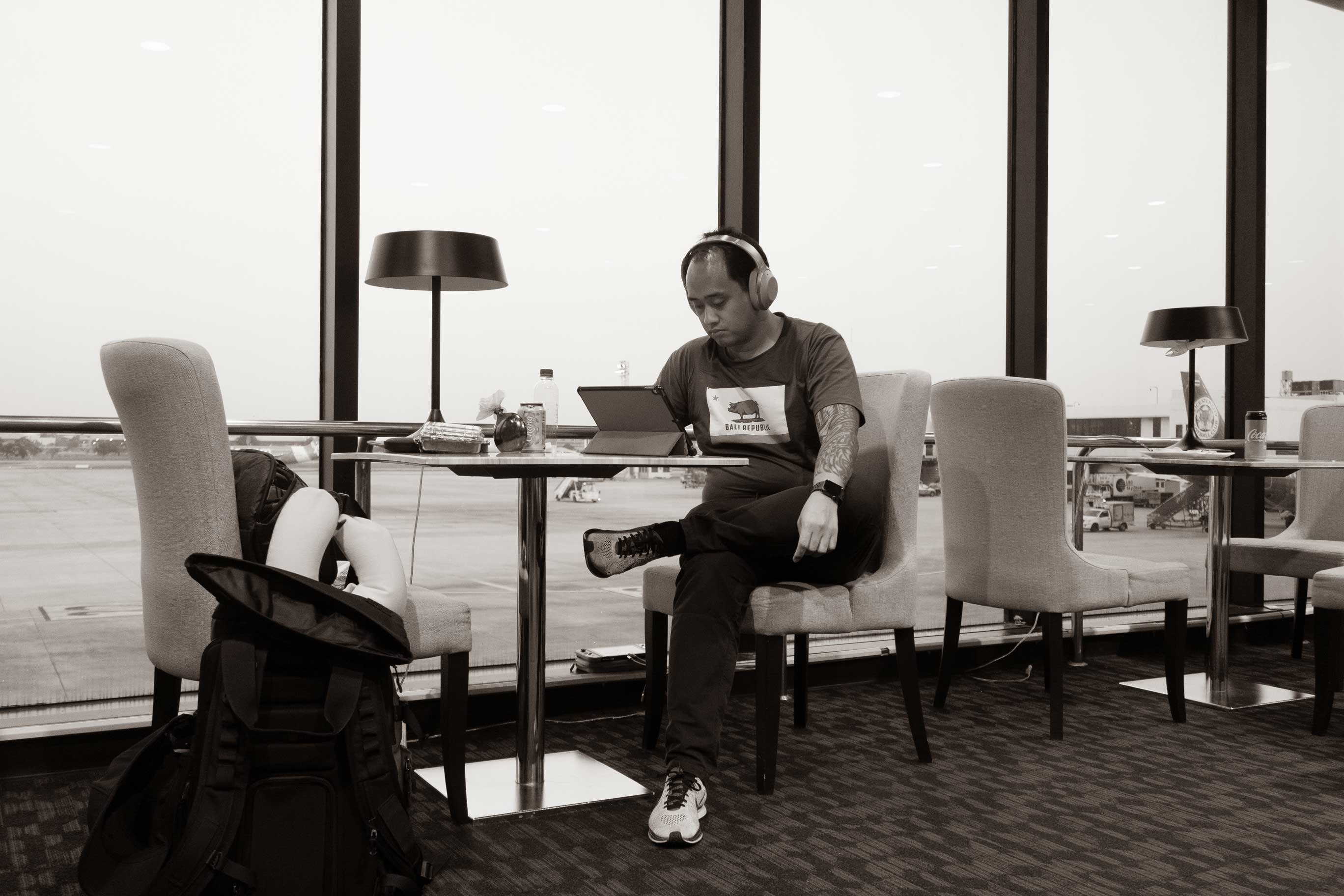Nico Sitting In An Airport Lounge Contact Me Page Header