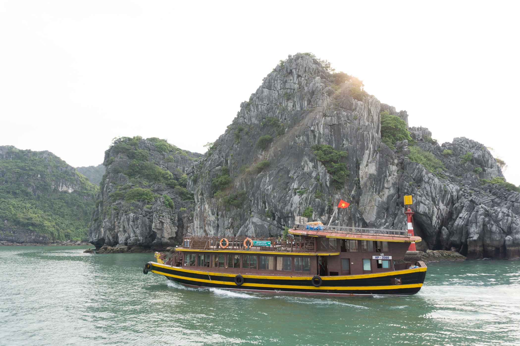Tug boat cruising along the Ha Long Bay Waters