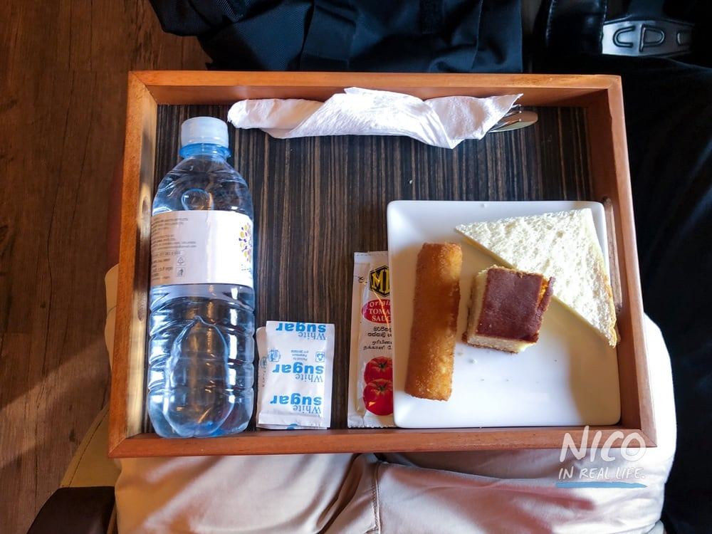 Tray of snacks and water on the Blue Line Train Colombo Kandy